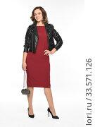 Купить «Стройная девушка в бордовом платье и черной косухе. Офисный стиль.», фото № 33571126, снято 11 октября 2016 г. (c) Светлана Голинкевич / Фотобанк Лори