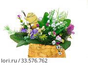 Easter basket from a flower arrangement on white background. Стоковое фото, фотограф Андрей Зык / Фотобанк Лори