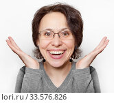 Купить «Portrait of a cheerful woman with glasses and short hair on a white background», фото № 33576826, снято 15 января 2018 г. (c) Элина Гаревская / Фотобанк Лори