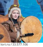 Купить «Female child dancing with tambourine in tradition clothing indigenous inhabitants Kamchatka Peninsula. Celebration Koryak national holiday Day of Seal - Hololo», фото № 33577106, снято 4 ноября 2018 г. (c) А. А. Пирагис / Фотобанк Лори