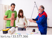 Купить «Young couple and old contractor in home renovation concept», фото № 33577366, снято 2 сентября 2019 г. (c) Elnur / Фотобанк Лори
