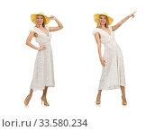 Купить «Woman in long summer dress and hat isolated on white», фото № 33580234, снято 22 октября 2014 г. (c) Elnur / Фотобанк Лори