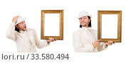 Man in white costume with picture frame. Стоковое фото, фотограф Elnur / Фотобанк Лори