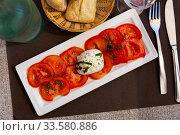 Traditional dish of Italian cuisine tomatoes and mozzarella cheese. Стоковое фото, фотограф Яков Филимонов / Фотобанк Лори