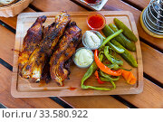 Baked pork ribs with pickles cucumbers and pepper. Traditional czech dish. Стоковое фото, фотограф Яков Филимонов / Фотобанк Лори