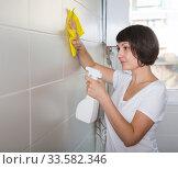 Купить «Woman washing tiles with rag», фото № 33582346, снято 22 ноября 2018 г. (c) Яков Филимонов / Фотобанк Лори