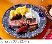 Купить «Grilled mix with baked potatoes and sauce», фото № 33582442, снято 8 июля 2020 г. (c) Яков Филимонов / Фотобанк Лори
