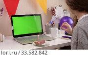 Купить «Woman celebrating birthday from home», видеоролик № 33582842, снято 19 апреля 2020 г. (c) Сергей Петерман / Фотобанк Лори