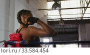 Купить «Mixed race woman resting after working out», видеоролик № 33584454, снято 15 мая 2019 г. (c) Wavebreak Media / Фотобанк Лори