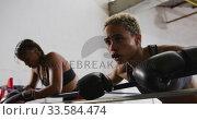 Купить «Two mixed race women resting after working out», видеоролик № 33584474, снято 15 мая 2019 г. (c) Wavebreak Media / Фотобанк Лори