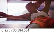 Купить «Mixed race woman resting in boxing gym», видеоролик № 33584534, снято 15 мая 2019 г. (c) Wavebreak Media / Фотобанк Лори