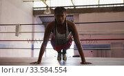 Купить «Mixed race woman working out in boxing gym», видеоролик № 33584554, снято 15 мая 2019 г. (c) Wavebreak Media / Фотобанк Лори