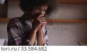 Mixed race woman using computer in bedroom. Стоковое видео, агентство Wavebreak Media / Фотобанк Лори