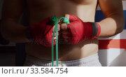Купить «Close up view of man with skipping rope in boxing gym», видеоролик № 33584754, снято 25 мая 2019 г. (c) Wavebreak Media / Фотобанк Лори