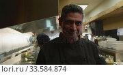 Купить «Caucasian man holding a dish», видеоролик № 33584874, снято 11 апреля 2019 г. (c) Wavebreak Media / Фотобанк Лори