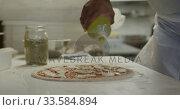 Купить «Mixed race man making a pizza», видеоролик № 33584894, снято 11 апреля 2019 г. (c) Wavebreak Media / Фотобанк Лори