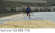 Front view of mixed race athlete doing long jump. Стоковое видео, агентство Wavebreak Media / Фотобанк Лори