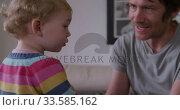 Купить «Close up view of man with baby at home», видеоролик № 33585162, снято 12 апреля 2019 г. (c) Wavebreak Media / Фотобанк Лори