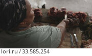 African woman cutting the meat. Стоковое видео, агентство Wavebreak Media / Фотобанк Лори