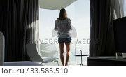 Купить «Caucasian woman walking in hotel room», видеоролик № 33585510, снято 13 мая 2019 г. (c) Wavebreak Media / Фотобанк Лори