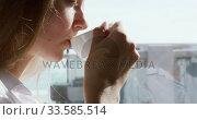 Close up view of caucasian woman drinking coffee in hotel. Стоковое видео, агентство Wavebreak Media / Фотобанк Лори