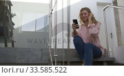 Купить «Caucasian woman smiling at her smartphone in hotel», видеоролик № 33585522, снято 13 мая 2019 г. (c) Wavebreak Media / Фотобанк Лори