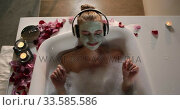 Купить «Caucasian woman taking bath while listening music in hotel», видеоролик № 33585586, снято 13 мая 2019 г. (c) Wavebreak Media / Фотобанк Лори
