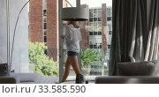 Купить «Caucasian woman drinking coffee in hotel room», видеоролик № 33585590, снято 13 мая 2019 г. (c) Wavebreak Media / Фотобанк Лори