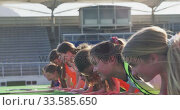 Купить «Female hockey players doing push-ups on the field», видеоролик № 33585650, снято 26 сентября 2019 г. (c) Wavebreak Media / Фотобанк Лори