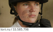 Caucasian woman putting on her helmet. Стоковое видео, агентство Wavebreak Media / Фотобанк Лори