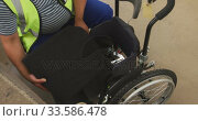Disabled man installing his wheelchair. Стоковое видео, агентство Wavebreak Media / Фотобанк Лори