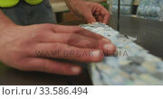 Worker cutting a piece of concrete block. Стоковое видео, агентство Wavebreak Media / Фотобанк Лори