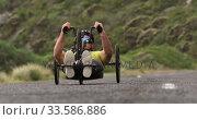 Купить «Disabled man riding a recumbent bicycle», видеоролик № 33586886, снято 16 апреля 2019 г. (c) Wavebreak Media / Фотобанк Лори