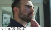 Купить «Business man thoughtful looking through the window», видеоролик № 33587274, снято 9 ноября 2019 г. (c) Wavebreak Media / Фотобанк Лори