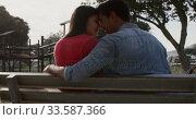 Купить «Young couple in love in a park», видеоролик № 33587366, снято 30 мая 2019 г. (c) Wavebreak Media / Фотобанк Лори