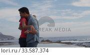 Купить «Young couple in love hugging», видеоролик № 33587374, снято 30 мая 2019 г. (c) Wavebreak Media / Фотобанк Лори