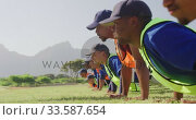 Купить «Baseball players making push ups», видеоролик № 33587654, снято 25 ноября 2019 г. (c) Wavebreak Media / Фотобанк Лори