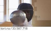 Купить «Female fencer athlete during a fencing training in a gym», видеоролик № 33587718, снято 16 ноября 2019 г. (c) Wavebreak Media / Фотобанк Лори