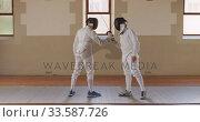 Купить «Fencer athletes during a fencing training in a gym», видеоролик № 33587726, снято 16 ноября 2019 г. (c) Wavebreak Media / Фотобанк Лори