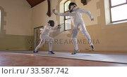 Купить «Fencer athletes during a fencing training in a gym», видеоролик № 33587742, снято 16 ноября 2019 г. (c) Wavebreak Media / Фотобанк Лори