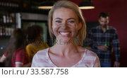 Купить «Woman looking at camera and smiling», видеоролик № 33587758, снято 15 ноября 2019 г. (c) Wavebreak Media / Фотобанк Лори