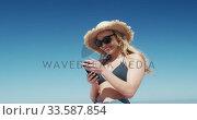 Купить «Woman enjoying free time on the beach», видеоролик № 33587854, снято 21 ноября 2019 г. (c) Wavebreak Media / Фотобанк Лори