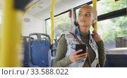 Купить «Mixed race woman taking the bus», видеоролик № 33588022, снято 10 января 2020 г. (c) Wavebreak Media / Фотобанк Лори