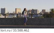 Купить «Mixed race woman walking on the street», видеоролик № 33588462, снято 23 февраля 2020 г. (c) Wavebreak Media / Фотобанк Лори