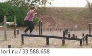Caucasian woman exercising at bootcamp. Стоковое видео, агентство Wavebreak Media / Фотобанк Лори