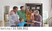 Happy parent with their children in a house. Стоковое видео, агентство Wavebreak Media / Фотобанк Лори