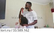 Купить «African american father and daughter brushing their teeth », видеоролик № 33589162, снято 14 января 2020 г. (c) Wavebreak Media / Фотобанк Лори