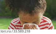 African american girl sneezing in a tissue outside . Стоковое видео, агентство Wavebreak Media / Фотобанк Лори