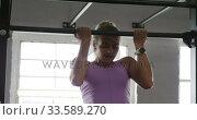 Купить «Front view athletic Caucasian woman doing chin ups», видеоролик № 33589270, снято 30 июля 2019 г. (c) Wavebreak Media / Фотобанк Лори