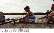 Купить «Male rowers laughing on the boat after practice», видеоролик № 33589322, снято 27 ноября 2019 г. (c) Wavebreak Media / Фотобанк Лори
